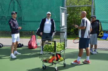 Trainer Branko Stamenic working on serves with some of the club members during the grand re-opening of the Thorncliffe Park Tennis Club.