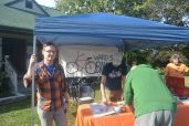 Brandon Quigley of Ward 30 Bikes encourages residents to sign the Danforth Loves Bikes pledge.