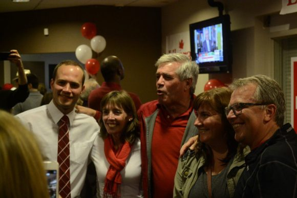 October 19, 2015. Newly elected MP Nathaniel Erskine-Smith, left, stands with Councillor Mary-Margaret McMahon, centre-left, MPP Arthur Potts, centre, and two supporters.