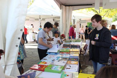 Young adults browse the books at the festival's stalls.