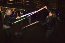 Two Star Wars fans duke it out in a lightsaber battle