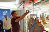 Toronto Maple Leafs forward Brad Boyes puts his donation Leaf on the Tree of Life at Shoppers Drug Mart.