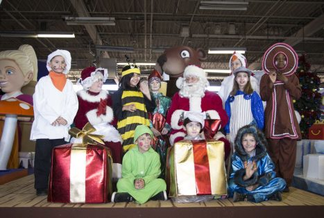 Santa Claus and Mrs. Claus with children who will be taking part in the annual Santa Claus Parade.