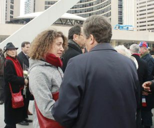 A woman cries as she speaks to Mayor John Tory about the tragic attacks.