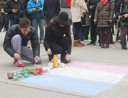 People gather around and light candles to remember the people that were killed.