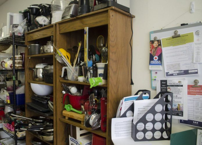 The walls of 'The Hub' are lined with donations that range from household items, toiletries, and clothing.