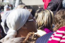 Sharon Young watches and wipes tears away as pallbearers place Rob Ford's casket into a hearse.
