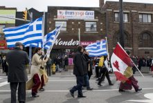 Both Greek and Canadian flags danced in the cold wind with marchers during the parade.