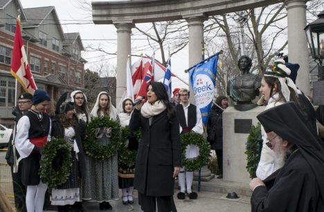 Anastasia Kakagiannis performs the Greek and Canadian national anthem to kick off the wreath-laying ceremony.