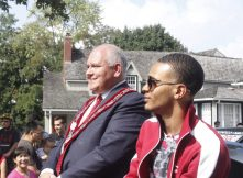 Markham Mayor Frank Scarpitti is along for the ride with Andre De Grasse.