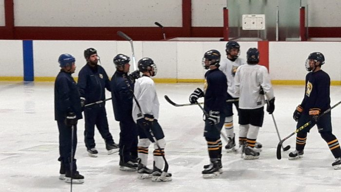 Coach Jason Nobili (third from left) conducting practice with the Toronto Titans midget team at Vaughan IcePlex in Concord, Ont. on October 7, 2016
