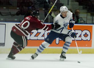 Nathan Bastian, right, was a key contributor in the Mississauga Steelheads offensive outburst with five assists in the game.