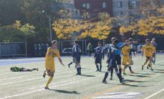 Midfield playmaker Tonko Baceli wheels away after opening the scoring for Queen's in the 41st minute.