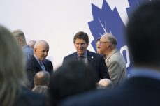 Maple Leafs Head Coach Mike Babcock and Dave Keon greet alumni before the ceremony