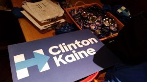 Posters and buttons were placed on a table during a viewing party held by Democrats Abroad Canada. The organization was first established in Toronto and now has chapters in 10 cities across Canada.