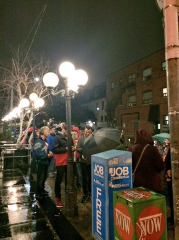Attendees waiting outside in the rain to get into the Hot Doc Ted Rogers Cinema for the U.S. Election viewing party.