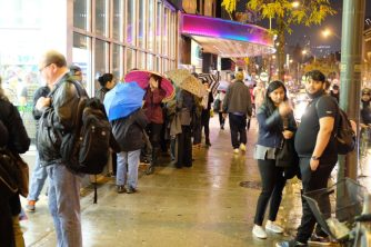 A long line formed outside the Hot Docs Cinema for the election night viewing party.