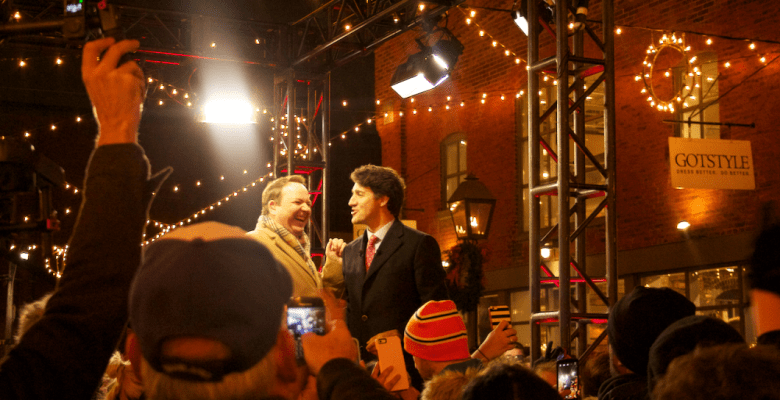 Justin Trudeau speaks with CTV weather man Tom Brown on-stage.
