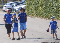 A young family of Blue Jays fans walk toward Florida Auto Exchange Stadium. (Jonathan Cheng photo)