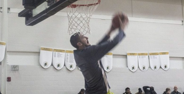 Centennial Colts player Marko Curic goes up for a dunk during shoot around at the OCAA All-Star Game