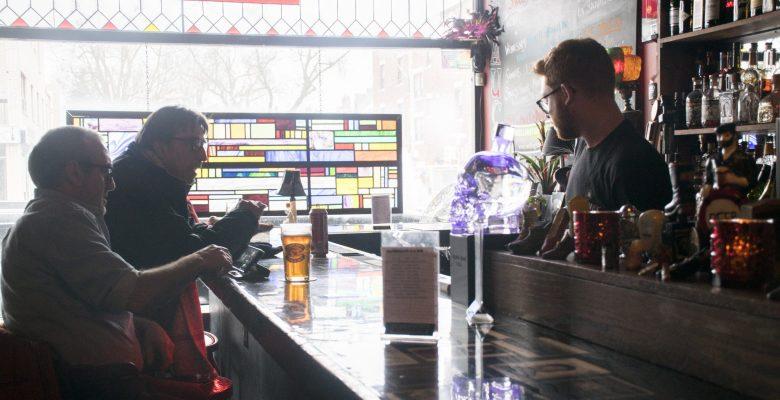 patrons at the bar at Sauce
