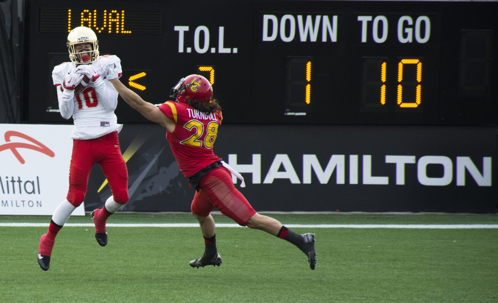 Calgary defender reaching for Laval player