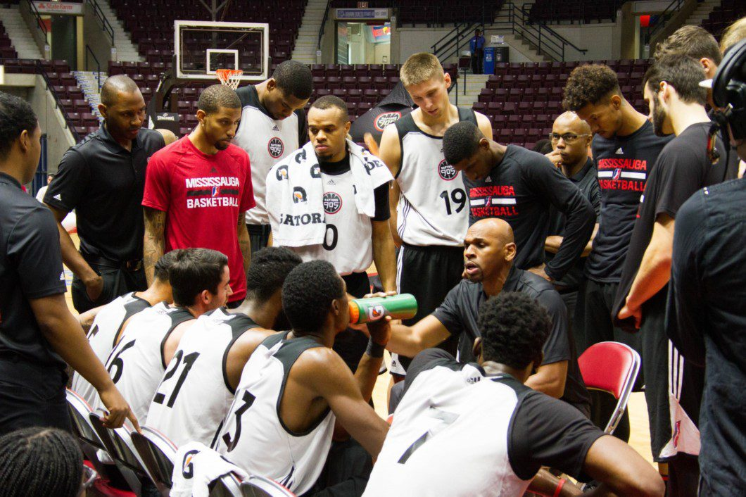 coach with basketball team