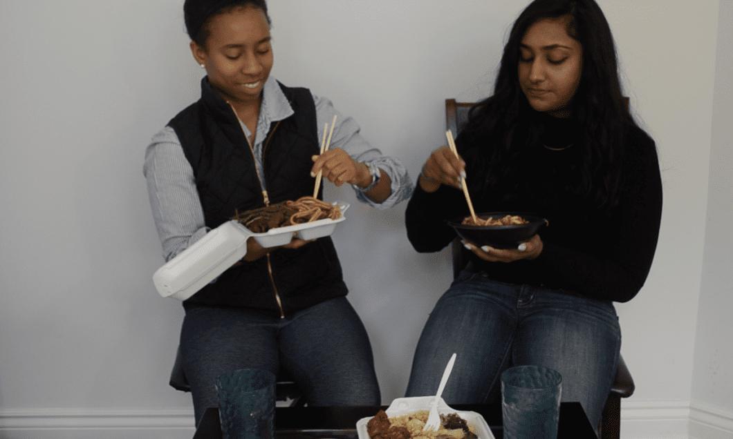 Krystal Reynolds and Melisha Ratnarajah eating