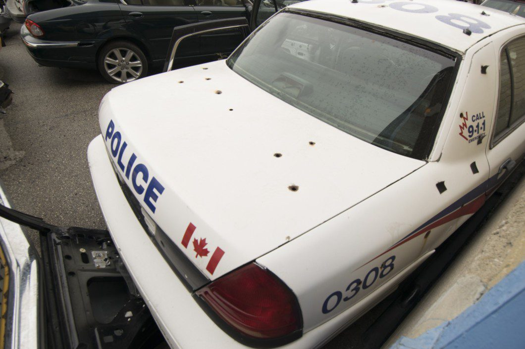 old police car with holes in trunk