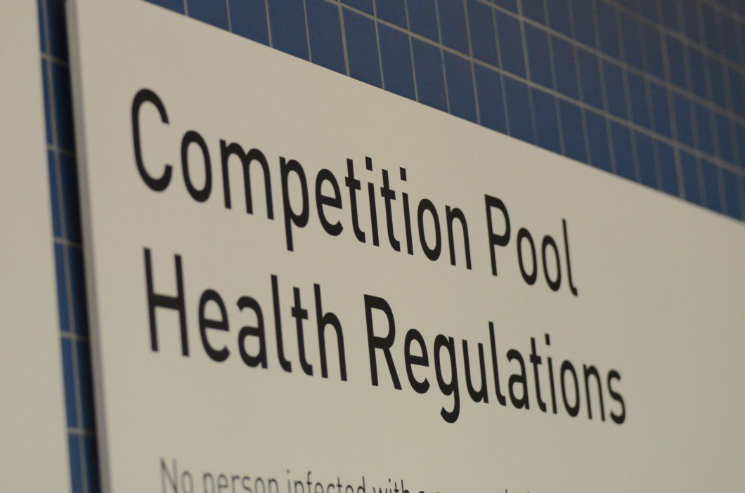 sign at the Competition Pool inside Pan Am pool building