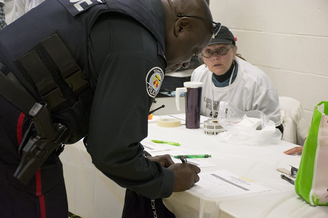 police officer signing paper