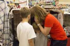 A mother and her two sons call their father and her husband, to discuss adopting a cat.