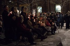 Moment of silence at the vigil in Barbara Hall Park, Tues. Feb. 13, 2018.