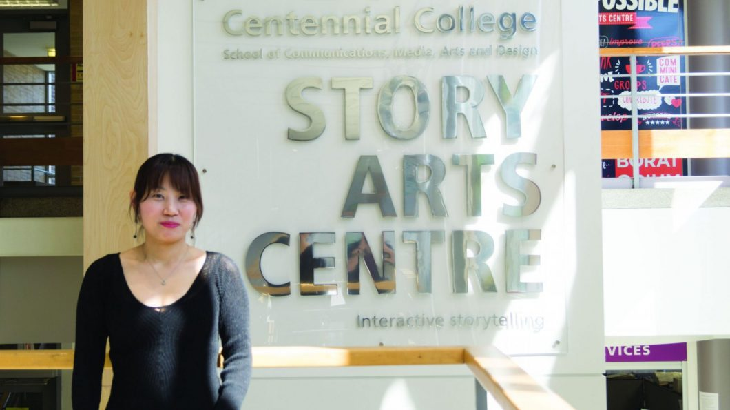 G-Hey poses in front of the Story Arts Centre sign. She made a short film for a class project that got chosen to be made into a feature-length film.