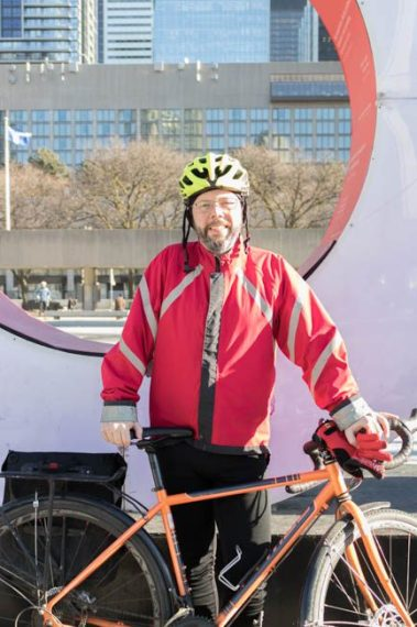 """Adam Hotchin, 48, at the die-in held in front of city hall March 26, 2018. He says the state of pedestrian and vulnerable road user safety in the city is """"shocking."""""""