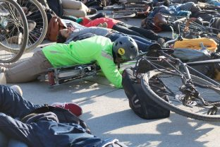 Demonstrators at the die-in held in front of city hall on March 26, 2018 in protest of better protection for pedestrians and cyclists.