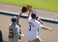 Fans with gloves trying to catch a ball