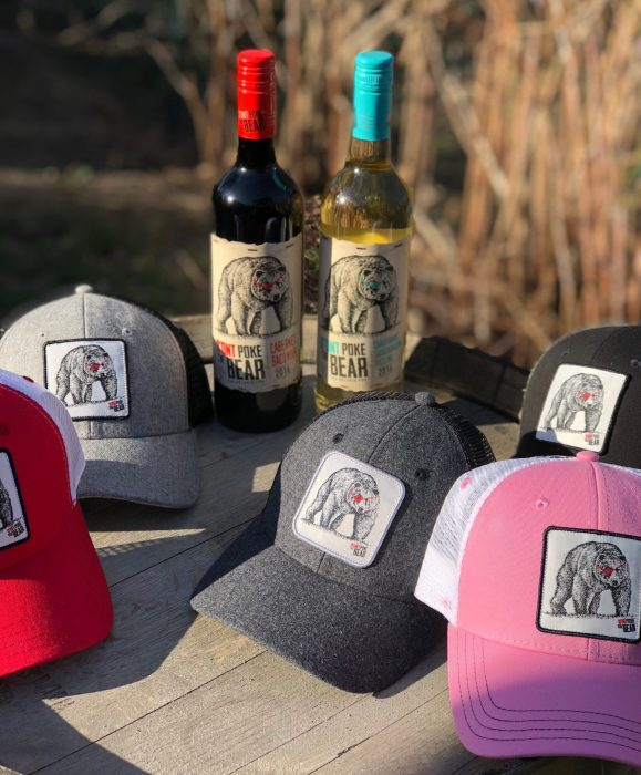 Don't Pole The Bear wine bottles and hats.