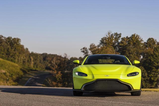 An Aston Martin Vantage road car in lime green