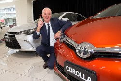 Toyota Executive Director, Sales and Marketing, Tony Cramb with one of Australia's best selling cars