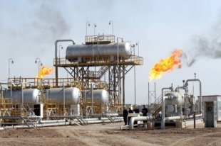 Engineers are seen at the Naher al-Umran gas refinery in Iraq in 2009. Iraq has signed deals with Turkish, Kuwaiti and South Korean energy firms to develop two gas fields to boost production