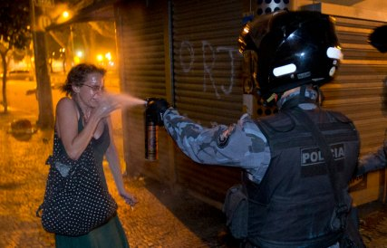 A military policeman pepper sprays a protester during a demonstration in Rio de Janeiro, Monday, June 17, 2013. AP Victor R. Caivano