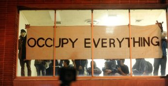 Occupy Oakland protesters claim a vacant building during a march on Wednesday, Nov. 2, 2011, in Oakland, Calif.