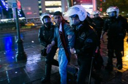 Police arrest a young man at the end of a demonstration. Up to 3,300 people have been arrested since the protests first began.