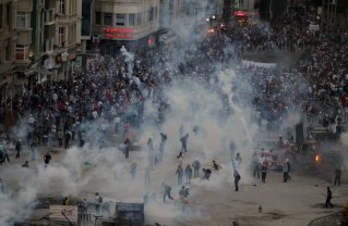 Police throw tear gas at protesters during clashes at the Taksim Square in Istanbul Tuesday, June 11, 2013. AP Thanassis Stavrakis