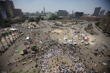 The other side Protesters on the opposing side - against former President Mohamed Morsi - perform Friday prayers at Tahrir square in Cairo as violence spread in the other camp