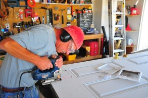 Grandpa Gary building Ollie a cat door. Not sure I'd ever have gotten around to this.