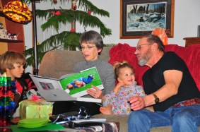 Grandpa and Grandma read the Tory and Tegan book. Tegan laughs