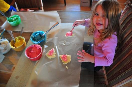 Tegan levitates a cookie beneath a spoon