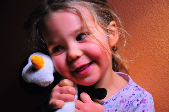 Tegan with her new penguin friend